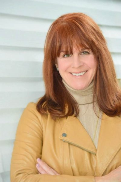 Podcaster, TV Show Host, Interviewer, Moderator and executive coach Jeanie Coomber